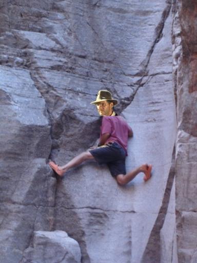 Gyno Guy scaling a cliff...wearing Crocs.
